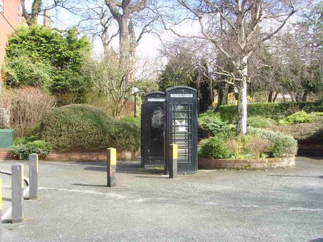 Black telephone boxes.