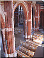 TQ3273 : Fire-damaged stonework in All Saints by Stephen Craven