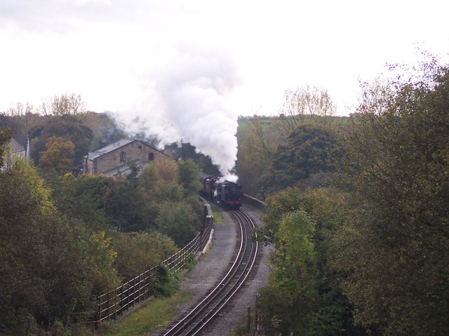 Steam train crosses the River Irwell at Brooksbottoms