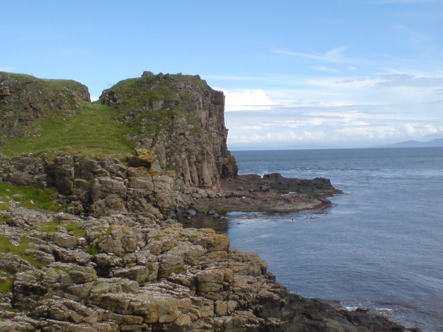 Robert the Bruce's Castle on top of cliff with Kintyre and Islay on the horizon.
