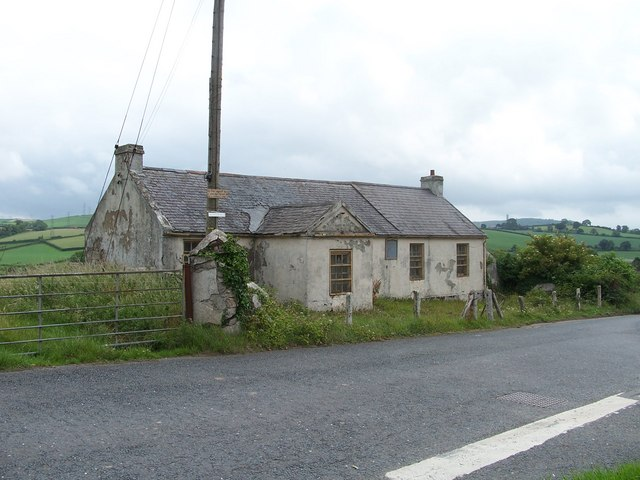 Ballystockart Mission Hall (derelict) with Scrabo Tower and hill in the distance
