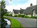 TL2379 : Thatched cottages in Wennington by Jonathan Billinger