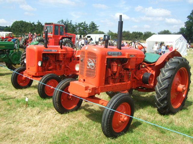 Two orange tractors