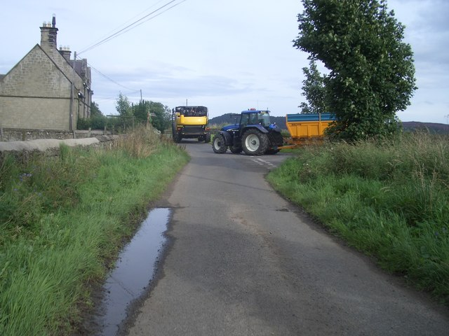 Farm machinery leaving Crosshill Farm road at High Houses
