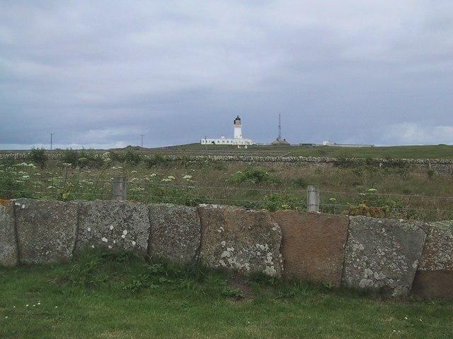 Lighthouse at Noss Head over a Caithness Stone Flag Wall