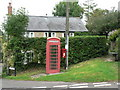 SY5388 : Puncknowle: postbox № DT2 82 and phone box by Chris Downer