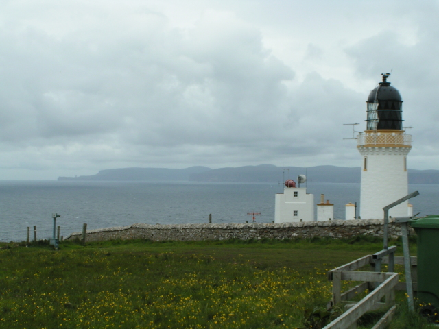 Dunnet Head lighthouse with the Orkney island of Hoy in the background