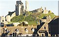 SY9681 : Corfe Castle Rises over the Village Rooftops by Sarah Charlesworth