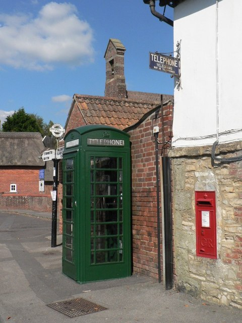 Okeford Fitzpaine: postbox № DT11 98 and phone