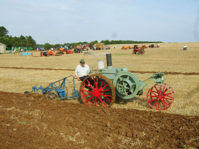 Vintage tractor and plough
