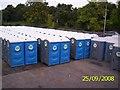 TL1896 : Portable toilets in Elliott Loohire depot by chris almond