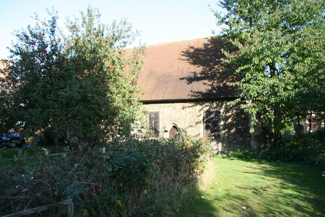 Duxford Chapel, hemmed in by trees and bushes
