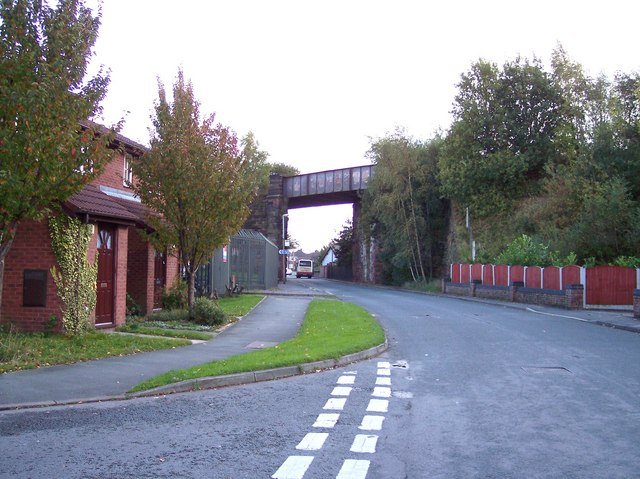 Disused railway bridge and sign for Transpennine Trail