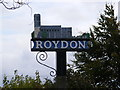 TM1080 : Roydon Village Sign by Adrian Cable