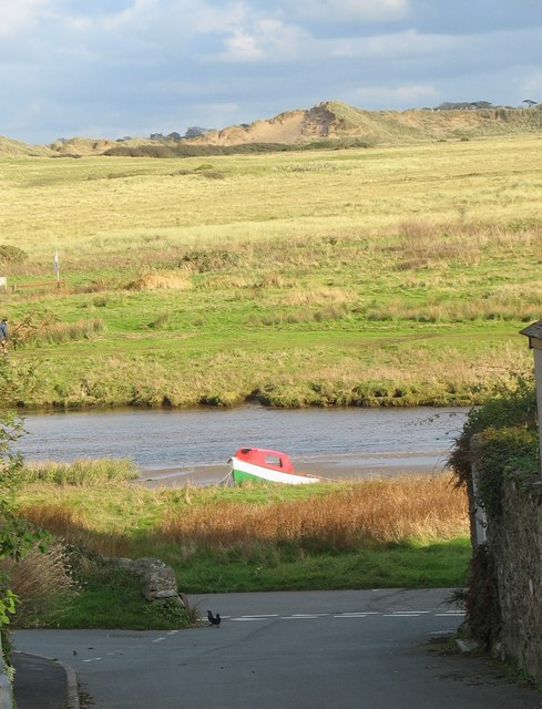 Painted in the national colours - a boat beached on the west bank of Afon Ffraw