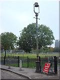 TQ3283 : Old street lamp, Bridport Place by Oxyman