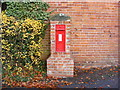 TM3569 : Four Cross Roads Victorian Postbox by Geographer