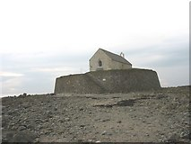 SH3368 : The sea defence wall of St Cwyfan's Church by Eric Jones