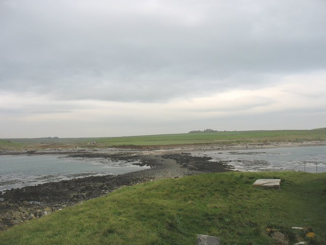 View landward across the causeway from St Cwyfan's Church