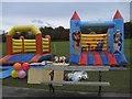 NZ2561 : Bouncy castles by michael ely