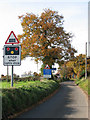 TG3023 : Approaching the level crossing on Roman Road by Evelyn Simak