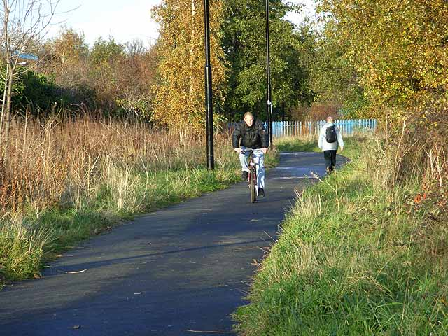 Cyclist and walker on Hadrian's Way at Wincomblee