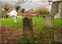 TG2834 : View across the churchyard by Evelyn Simak