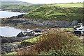 SH1934 : Fisherman launching boat at  Porth Colmon by Ian Warburton