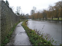 SU9948 : Long wall running parallel to the River Wey heading into Guildford by Basher Eyre