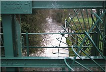 SU9948 : View through the sluice gate approaching Guildford on the River Wey by Basher Eyre