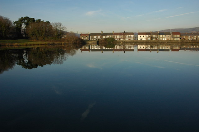 Houses reflected in North Lake, Caerphilly