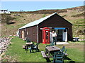 NB9908 : Summer Isles Post Office and tea room by PETER PLUCKNETT