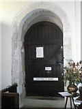 SU8014 : Door to the vestry at St Peter, East Marden by Basher Eyre