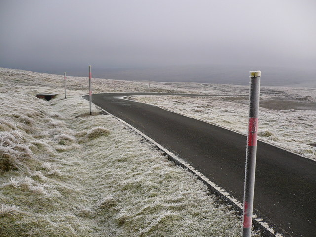 Snow poles on access road to Great Dun Fell Radar Station