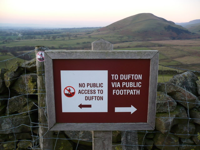 Sign on access land with Knock pike in the background
