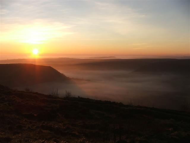 Sunset and fog over the Hole of Horcum
