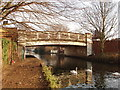 TQ1278 : Grand Union Canal bridge 203 - Norwood Road by David Hawgood