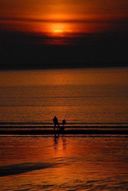 Rod fishing on Barmouth Beach
