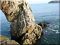 SH4094 : The seaward limb of the Porth Wen Sea Arch with Trwynbychan point in the background by Eric Jones