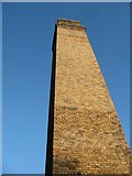 SH4094 : One of two chimney stacks at Porth Wen Brick Works by Eric Jones