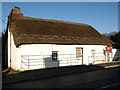 SN5167 : Interesting thatched roof cottage by Neil Parker