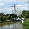 SP3683 : The Oxford Canal with a pylon, near Bedworth by Roger  Kidd