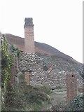 SH4094 : Silica bins and chimneys at Porth Wen brick works by Eric Jones