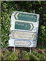 SY9695 : Corfe Mullen: old and even older sign at Jubilee Cross by Chris Downer