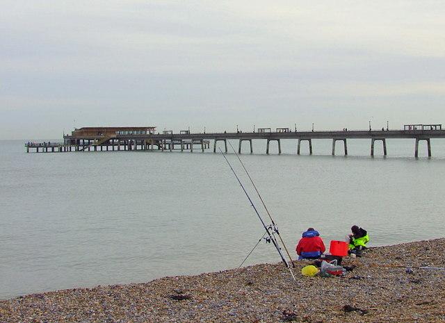 Shoreline fishermen,with Deal Pier in background