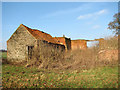 TG1330 : Abandoned farm buildings at the end of Keeper's Lane by Evelyn Simak