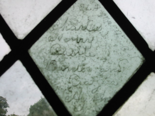 Early graffiti on pane of glass