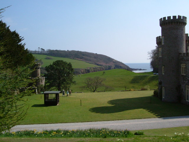 Caerhays Castle with view to headland above Porthluny Cove