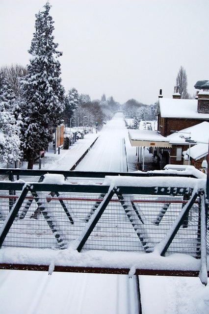 Railway tracks covered by snow, Ewell West station