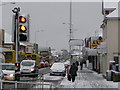 SZ0894 : Winton: traffic buildup on snowy day by Chris Downer